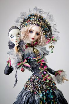 I owned a costume shop for ten years so costumes like this enthrall me. Art doll by Marina MasLova