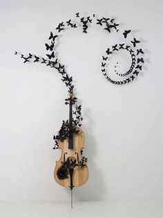 Paul Villinski - New York, NY... I have an old guitar this is a good idea on how to decorate with it.... Maybe use notes?