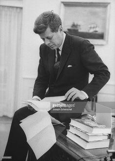 News Photo : President John F. Kennedy working in the White...