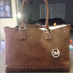 MICHAEL KORS BROWN SUEDE PURSE W/wallet & dustbag 100% authentic brown Michael KORS purse with matching wallet. No flaws. Brand-new with tags. Also includes dust bag.  Great gift at a super reduced price! Michael Kors Bags