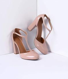 """We never cease to amuse ourselves with these feminine retro T-straps. Soft and ladylike, the blush pink patent leather heels are an elegant match to any vintage ensemble. Featuring a 4"""" pump, these beauties have an adjustable and gored buckle, rounded toe, and soft sole inlay. Ideal for a leading lady!"""