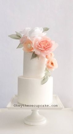 White Fondant Cake With Pale Peach and White Wafer Paper Flowers. | Stevie Auble Cake