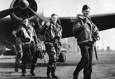"""A crew of a RAF bombing squadron gives the """"thumbs up"""" signal on 22 April 1940 when they returned to their home base after attacking German warships off Bergen, Normandy during the country's invasion."""