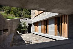 Renovated Barn into Three Story House for Inspirations: Cozy Open Patio With Stone Floor Concrete Wall And Wooden Shutters In The Barn In Soglio ~ CLAFFISICA Architecture Inspiration Concrete Houses, Concrete Floors, Concrete Wall, Three Story House, Barn Renovation, Wooden Shutters, Wood Architecture, Inspiration Design, Stone Houses