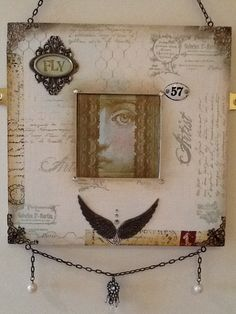 Paint effects on an ikea mirror, stamps by inkylicious, Tim Holtz embellishments, found objects from a flea market. 2012