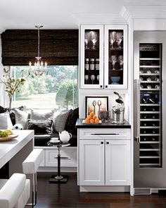 Conveniently tucked into one corner of the kitchen is a beverage center complete with a space-saving wine refrigerator 1½ feet wide and 7 feet tall. Glasses are stored next to the fridge in a cupboard above the black quartz bar counter. I like this but bar area and cabinet needs to be larger...also need ice machine.