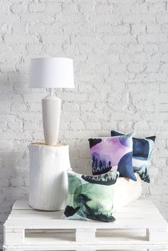 Maisema Cushion Cover | Pentik | Designed by Liina Harju, Maisema (Landscape) fabric has a mysterious, dreamy feeling. Its dark tree silhouettes remind us of typical Finnish landscape seen from the train window.