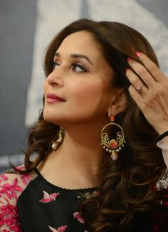 Indian Bollywood actress Madhuri Dixit looks on during a promotional event for the forthcoming film 'Dedh Ishqiya' in Ahmedabad. Indian Bollywood Actress, Bollywood Fashion, Indian Actresses, Indian Celebrities, Bollywood Celebrities, Madhuri Dixit Saree, Sabyasachi, Preity Zinta, Karisma Kapoor