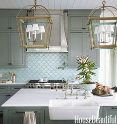 The ocean's shimmery hues inspire a kitchen in Santa Rosa Beach, Florida, by Urban Grace Interiors. See more designer kitchens   - HouseBeautiful.com