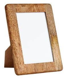 beige premium quality wooden photo frame with a stand and eyelets at back for