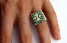 How to fold a dollar bill ring, a cool piece of money origami. Simple step by step photos make learning this moneygami easy, plus there are video instructions too.