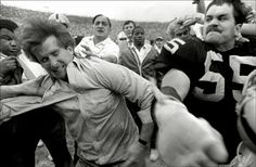 Matt Millen punches New England owner Patrick Sullivan in the face after a 1984 Pats-Raiders playoff game.