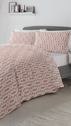Add a geometric flare to your bedroom with the Jax duvet set. The duvet cover features a modern geometric design in white on a rich coral background. The set is fully reversible with a reverse colour geometric pattern on the reverse. Complete the look with crisp white sheets and lamp.