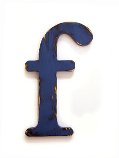 Wooden Letter F (Pictured in Navy)Pine Wood Sign Wall Decor Rustic Americana Country Chic Wedding Photo Prop Nursery Kids Decor. $28.00, via Etsy.