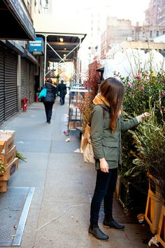 street style - green army jacket. skinny jeans. long brown hair. black chelsea boots.
