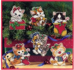 Christmas Kittens, plastic canvas, cover page, page 1/8. I have cross stitched these Christmas kittens and they are gorgeous, a must on any ones Christmas tree.