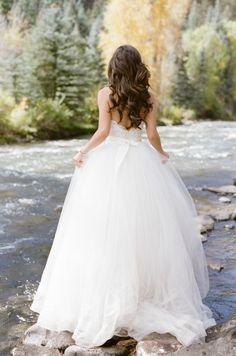 Gorgeous + traditional ballgown: http://www.stylemepretty.com/colorado-weddings/telluride/2016/01/22/romantic-intimate-telluride-elopement/   Photography: Tamara Gruner - http://tamaragruner.com/