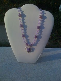 handcrafted amethyst & silver stone pendant with amethyst barrel stone's & lilac & clear swarovski crystals make up this uniquely beautiful necklace designed By southern Starr designs orginal price 60.00 on sale Now for 45.00