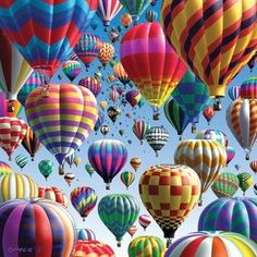 Beautiful Art of colorful hotair balloons fililng the bright blue sky.