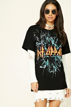 "A knit tee featuring a ""Def Leppard"" front graphic, a ""Back By Popular Demand Worldwide Tour"" back graphic, a round neckline, short sleeves, and a longline silhouette."