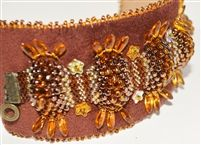 """Sophie weaves gold, copper, and brown Czech and Japanese Seed Beads into a supple and elegant cuff to usher in the Autumn Season. Embroidered onto soft brown ultra-suede, this piece is appealing to touch and pleasing to the eye. Secured by a ball-and-socket closure; measuring 7"""" long by 2"""" wide.Autumn Picks Cuff"""