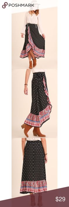 """Gypsy Sun Wrap Maxi Skirt On trend wrap maxi skirt with front ruffle. Great festival look or just for the daily wanderer. Pair with a white crop or over a black bodysuit and you are ready for a day of Bohème adventure. Amazing quality fabrication and created by Los Angeles designers.   ✖️No trades, thank you!   Bundles welcome!   Reasonable best offer considered when submitted with the """"offer"""" button   My measurements in Bio  Happy poshing and please let me know how I can better serve you…"""