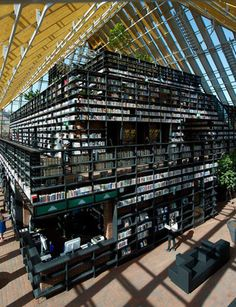 Book Mountain, Spijkenisse, The Netherlands: 9,300 square meters of glass, stairs, and reading material culminating into a wide open reading space at the top, to challenge the intimidating stuffiness of libraries of old. | Atlas Obscura