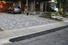 Yay, no more scraping our cars. That was the sound of our cars bottoming out in the gutter every time we pulled. Driveway Apron, Block Paving Driveway, Driveway Design, Curb Ramp, Sidewalk, Yard, Driveways, Fence, Alternative