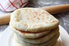 Pita bread making. Pita bread is one of the most useful recipes to have at home. Pita bread can be cut into wedges, toasted then used as chips or to make delicious sandwiches in the pocket stuffed with savory fillings. Homemade Pita Bread, Homemade Tahini, Bread Recipes, Cooking Recipes, Cooking App, Grilled Flatbread, Food Videos, Bakery, Food And Drink