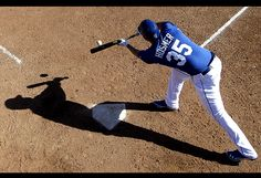 Baseball spring training  Kansas City Royals first baseman Eric Hosmer bunts during baseball spring training in Surprise, Ariz.