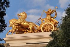 This is the Greek God Apollo at the top of the Parc de la Ciutadella Fountain.  In Greek mythology, Apollo was the God of the Sun so we can see him depicted here in all gold, at the top of the fountain with his carriage to symbolize him riding into the sun.