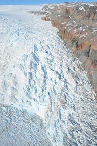 Greenland Ice sheet tumbling toward a calving margin in an East Greenland fiord near Kulusuk.