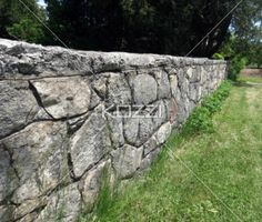 A beautiful, old stone wall beside a country road.