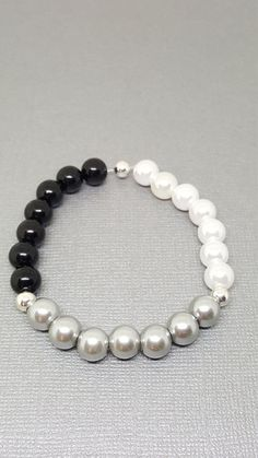 Check out this item in my Etsy shop https://www.etsy.com/ca/listing/517166273/pearl-bracelet-prom-bracelet-wedding