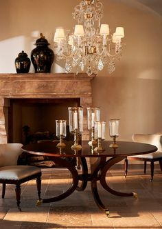 The #RLHome Louis XV style, Alexandra chandelier sparkles above the Biedermeier, mahogany Alleyn dining table.