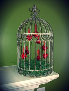 DIY Valentine Decorations.     Caged floating hearts. Again used decorate bird cage from Michael's. Bought heart ornaments and attached with clear thread.