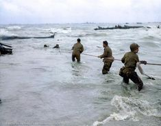 Stunning newly colorized PHOTOS bring D-Day back to life 4th Infantry Division, 101st Airborne Division, Normandy Invasion, Landing Craft, Colorized Photos, Paratrooper, National Archives, D Day, War Machine