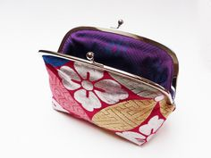 Multi colour and metallic silver woven obi clutch by cheekyleopard