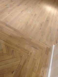 Tumbled oak with lye and white oil again, just to show the two line brass border we put in. This floor is in Tommy Hilfiger in regents street.