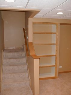 #HomeOwnerBuff Stairs to basement with built in shelving