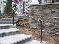 exterior curved wrought iron handrails is part of Escaleras exterior Curvas - This exterior curved wrought iron handrail beautifull complements the stone stairs Iron Handrails, Wrought Iron Stair Railing, Stair Handrail, Wrought Iron Fences, Iron Railings, Hand Railing, Porch Railings, Exterior Stair Railing, Outdoor Stair Railing