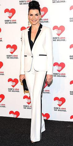 JULIANNA MARGUILES What, did Michael Kors run out of dresses for the God's Love We Deliver event in N.Y.C.? The actress opts for a chic white tuxedo with black detail by the designer, plus blingy earrings and a cool updo.