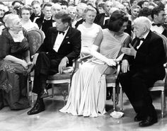 1962 - Mr. and Mrs. Kennedy attend a dinner in honor of the Nobel Prize winners of the Western Hemisphere.  From L-R: Pearl Buck, President Kennedy, Mrs. Kennedy, and Robert Frost.