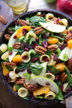 A simple pasta + spinach salad with crunchy apples, celery, and toasted pecans, chewy dried cranberries, sweet mandarine oranges and coated in a delicious poppyseed vinaigrette.