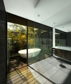 Instead of block glass, create a privacy walled garden with some kind of water feature and enlarge window for shower area - AMAZING