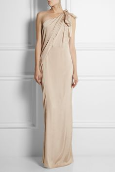 LANVIN One-shoulder draped satin-jersey gown $4,480 Deftly draped through the body and split at the skirt, Lanvin's mocha gown is especially flattering on athletic and statuesque frames. The fluid satin-jersey is blended with a touch of silk for added lustre. Draw attention upwards to the one-shoulder neckline by styling yours with statement earrings.  Shown here with: Lanvin earrings, Jimmy Choo shoes, Bottega Veneta clutch.