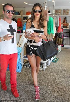 Is red the new trend? Model Alessandra Ambrosio and fashion stylist friend Matheus Mazzafera wore the colour proudly while shopping today in Beverly Hills