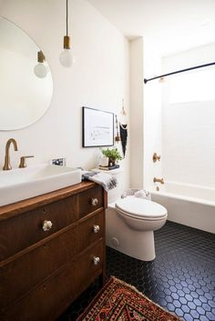 tiled bathroom with vintage rug