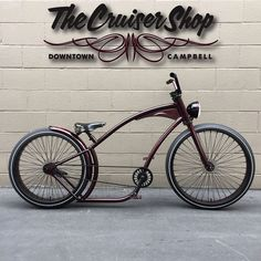 Downtown Campbell: Hard Time... Designed by #thecruisershop and now manufactured for us by #ruffcycles. Just finished this one up for a customers....rolls on a 26x4 in rear and a 29x3 up front 72 spoke wheels Sram 2speed automatic in rear Godspeed up front. Bike was powder coated with @prismaticpowders illusion Malbec by @rcrefinishing. Other parts on the bike - 140mm ruff cranks profile chain ring rear fender @brooksengland saddle and our LED finished off with some pinstriping by…