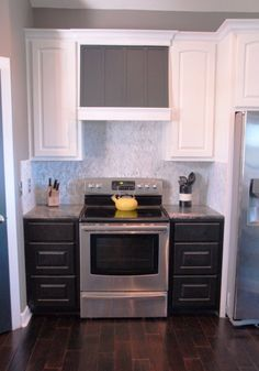 prime and paint a diy custom range hood, The Rozy Home featured on Remodelaholic- dark light and grey mix up